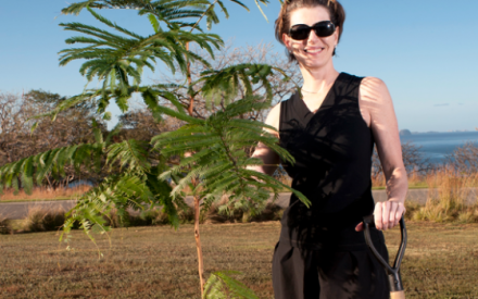 Four Seasons President and CEO Kathleen Taylor plants a tree in Costa Rica.