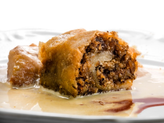 Honey black pudding strudel with egg sauce, blood and baken apple icecream (chef Ana Roš)